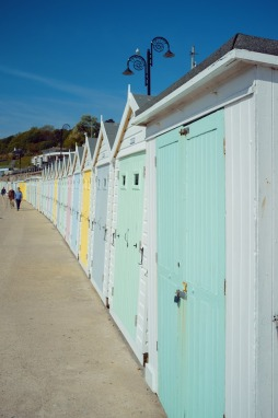 Pastel coloured beach huts